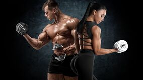 Free Sporty Couple Workout With Dumbbells. Muscular Man And Woman Showing Muscles Royalty Free Stock Images - 169097679