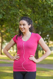 Sporty cute woman wearing sportswear posing in a park Stock Photo