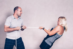 Sporty determined woman and man pulling a rope Royalty Free Stock Photo