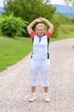 Sporty elderly woman doing sport exercises stock photo