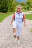 Sporty elderly woman doing sport exercises stock image