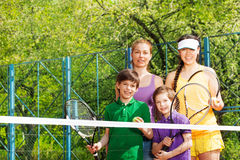 Sporty family preparing to start a tennis set Royalty Free Stock Photography