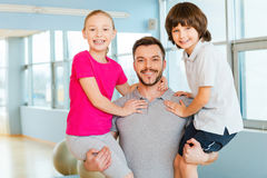 Sporty father with kids. Stock Images