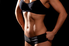 Sporty female body on black background Stock Image