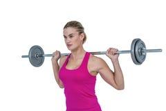 Sporty female bodybuilder lifting barebell Royalty Free Stock Photo