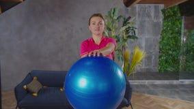 Sporty female doing stability ball steering wheel exercise