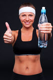 Sporty female holding water Royalty Free Stock Images