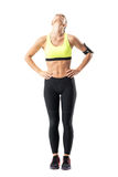 Sporty female jogger stretching neck muscles with head titled back. Royalty Free Stock Photography