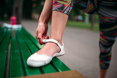Sporty female person buttons footwear Stock Photo