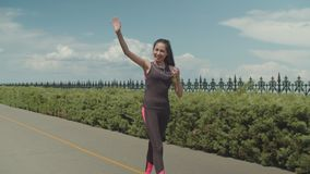 Sporty female runner meeting friend in city park stock video