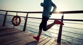 Runner running on seaside boardwalk Royalty Free Stock Photography
