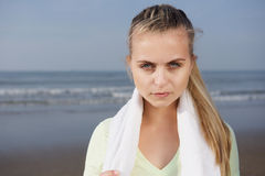 Sporty female with serious expression at the beach stock photography
