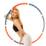 Sporty fit girl doing exercise with hula hoop. Stock Photography