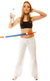 Sporty fit girl doing exercise with hula hoop. Stock Photos