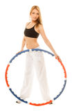 Sporty fit girl doing exercise with hula hoop. Royalty Free Stock Photography