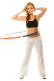Sporty fit girl doing exercise with hula hoop. Stock Photo