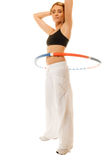 Sporty fit girl doing exercise with hula hoop. Royalty Free Stock Images