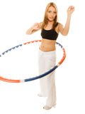 Sporty fit girl doing exercise with hula hoop. Stock Image