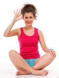 Sporty fit happy woman giving OK sign Royalty Free Stock Photo