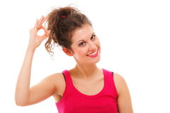 Sporty fit happy woman giving OK sign Stock Photo