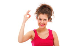 Sporty fit happy woman giving OK sign Stock Images