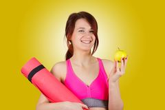 Sporty fit healthy smiling beautiful woman, red head girl holding an yoga mat royalty free stock photos