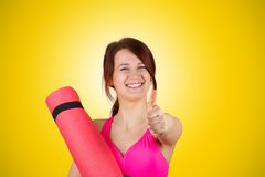 Sporty fit healthy smiling beautiful woman, red head girl holds an yoga mat royalty free stock images