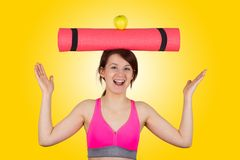 Sporty fit healthy smiling beautiful woman, red head girl holds an yoga mat stock photos