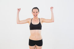 Sporty fit woman clenching fists against wall Stock Images