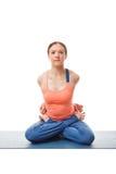 Sporty fit woman doing  Ashtanga Vinyasa yoga asana Baddha Padma. Sana - bound restrained lotus pose isolated on white Stock Photos