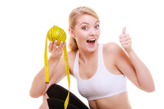 Sporty fit woman with measure tape fruit. Time for diet slimming. Royalty Free Stock Photos