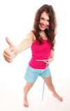 Sporty fit woman with measure tape thumbs up Royalty Free Stock Photos