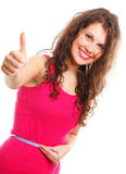 Sporty fit woman with measure tape thumbs up Royalty Free Stock Photography