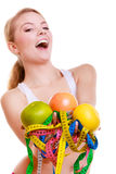 Sporty fit woman with measure tapes fruits. Time for diet slimming. Stock Images