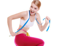 Sporty fit woman with measure tapes. Time for diet slimming. Royalty Free Stock Images