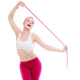 Sporty fit woman with measure tapes. Time for diet slimming. Stock Image