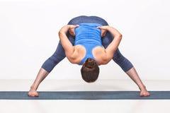 Sporty fit woman practices Ashtanga Vinyasa yoga Stock Photos