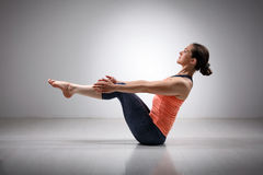 Sporty fit woman practices Ashtanga Vinyasa yoga stock image