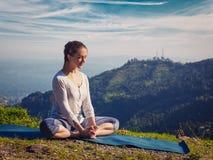 Sporty fit woman practices yoga asana Baddha Konasana outdoors Stock Photo
