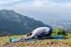 Sporty fit woman practices yoga asana Balasana Royalty Free Stock Image