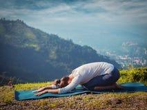 Sporty fit woman practices yoga asana Balasana Stock Images