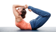 Sporty fit woman practices yoga asana Dhanurasana Royalty Free Stock Photo
