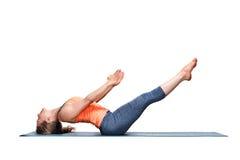 Sporty fit woman practices yoga asana Uttana padasana Royalty Free Stock Photos