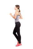 Sporty fit woman running. Full body length portrait isolated over white background Royalty Free Stock Photos