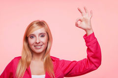 Sporty fit woman showing ok sign hand gesture Stock Image