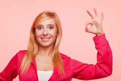 Sporty fit woman showing ok sign hand gesture Stock Photo