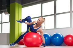 Sporty Fit Woman Stretches On Ball Royalty Free Stock Photo