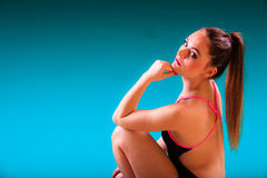 Sporty fit woman at swimming pool edge poolside. Royalty Free Stock Images