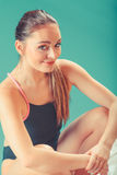 Sporty fit woman at swimming pool edge poolside. Stock Photos