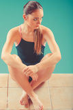 Sporty fit woman at swimming pool edge poolside. Stock Image